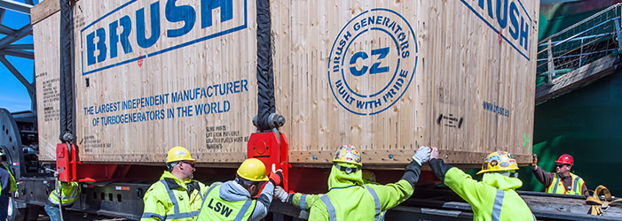Workers lowering a container